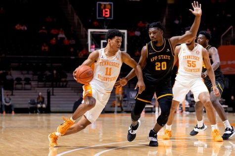 App State junior guard Adrian Delph defends Tennessee freshman guard Jaden Springer in the Mountaineers