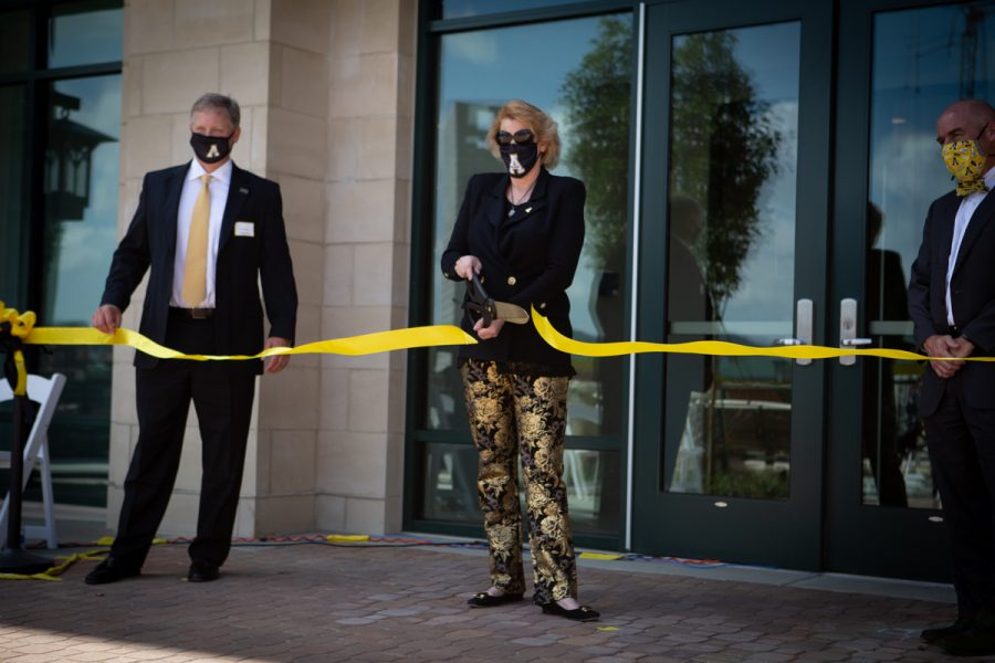 Chancellor Sheri Everts cuts the ribbon on Raven Rocks Residence Hall Thursday. Raven Rocks is one of two new dorms that were built on West Campus this year.