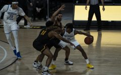 App State players Donovan Gregory (#11, left) and Deshon Parker (right) swarm Georgia State guard Kane Williams during the Mountaineers 74-61 win on Saturday at the Holmes Center.
