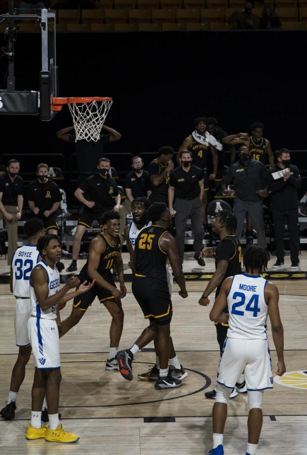 App State junior forward James Lewis Jr. (#25) flexes his muscles and celebrates with teammates late in App States win over the Panthers on Saturday. Lewis led the Mountaineers with a career-high 22 points and 14 rebounds in the game.