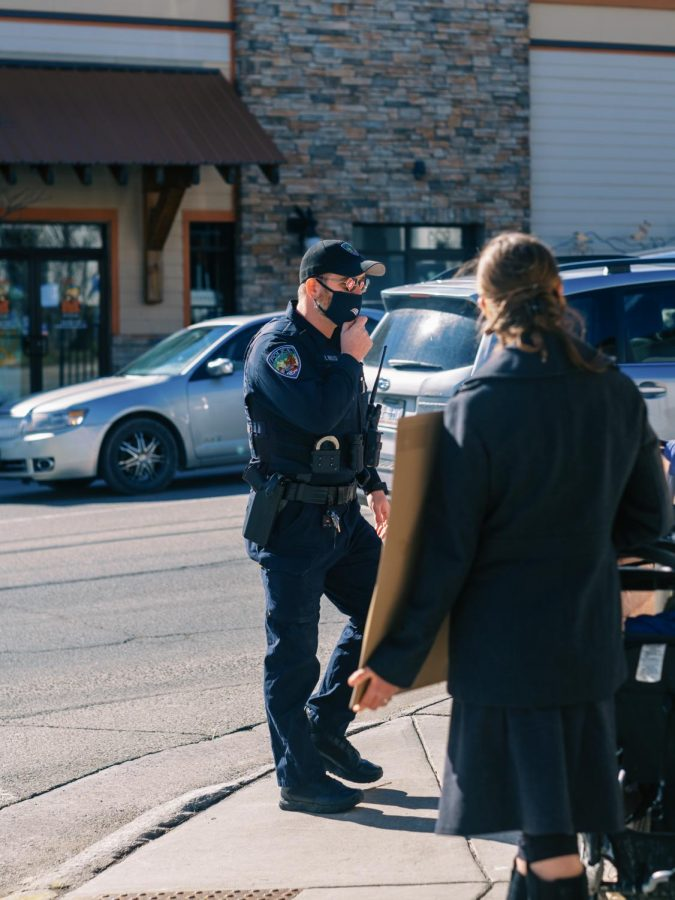 During the protest, a Boone Police Department officer offered water to the protestors outside the Watauga County government building on King Street.