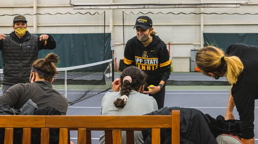 First year App State women's tennis head coach Ashleigh Antal coaches her team during a recent practice. The Mountaineers begin the 2021 season Sunday at 1 p.m. in Raleigh against the Wolfpack of NC State.