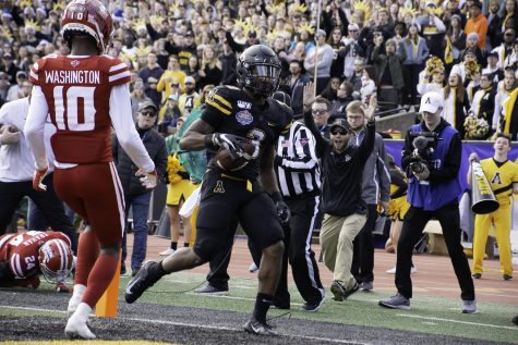 "Former App State standout running back Darrynton Evans scores a touchdown in the 2019 Sun Belt Championship game. ""The first event the commission assisted was the Sun Belt football Championship when App State hosted the University of Louisiana at Kidd Brewer Stadium in Boone,"" said Jackson."