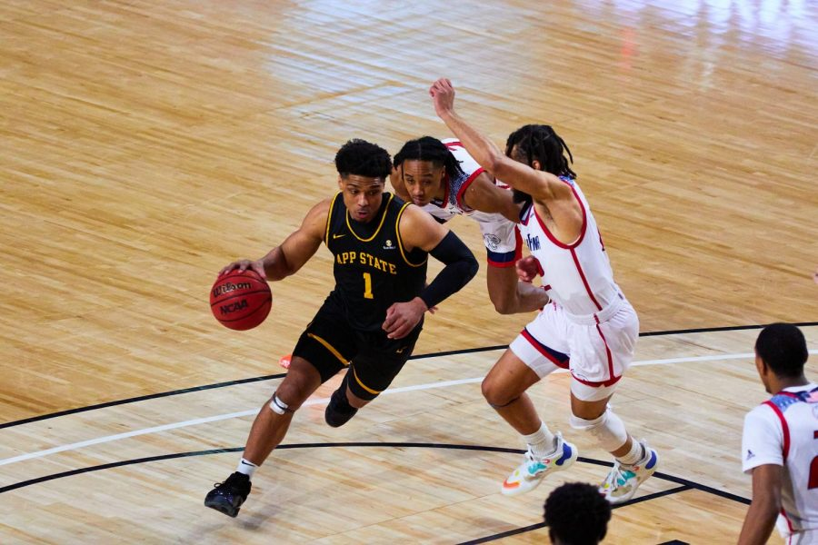 App State senior guard Justin Forrest drives towards the lane during the Mountaineers' Senior Day 56-54 loss to South Alabama on Saturday. Forrest led the Mountaineers with 20 points in the game to go along with six rebounds.