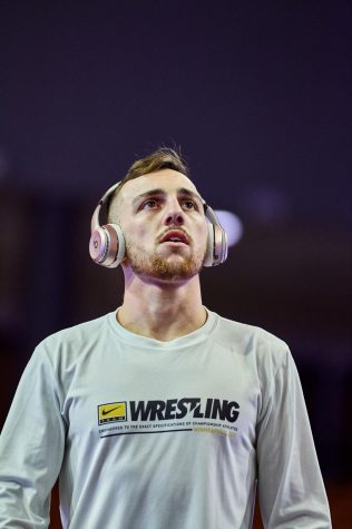 App State redshirt senior wrestler Codi Russell looks on before a match this season. The Atlanta native is currently ranked in the Top 25 in the NCAA at 125 pounds by all five major outlets. (The Open Mat, TrackWrestling, WrestleStat, Flo Wrestling, InterMat)