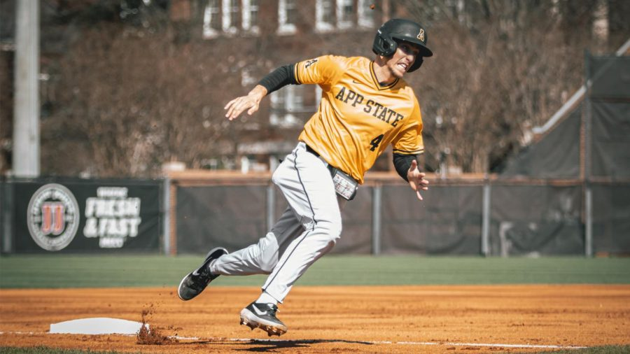 App State junior middle infielder Luke Drumheller hustles around third base during a game at UNC Greensboro last season. The Charlotte native broke out in his freshman season of 2019, leading the Mountaineers in batting average, hits, RBIs, doubles and OBP, en route to being named a freshman all-American by Collegiate Baseball News.