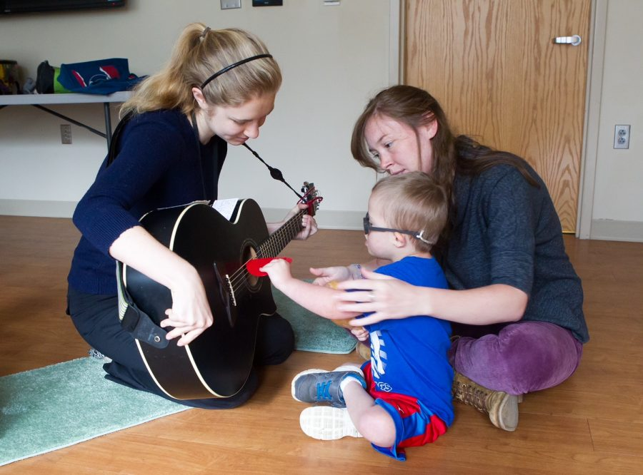 Students with a participant during a music therapy session before COVID-19. Now, the Bachelor of Music in Music Therapy program has taken its program virtual and offers free and remote music therapy.