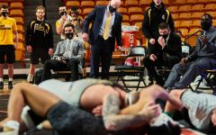 App State wrestling coaches focus on a match between senior Codi Russell and an opponent from Gardner-Webb on Jan. 23 in Buies Creek. (From right: assistant coach Randall Diabe, head assistant coach Ian Miller, head coach JohnMark Bentley.)