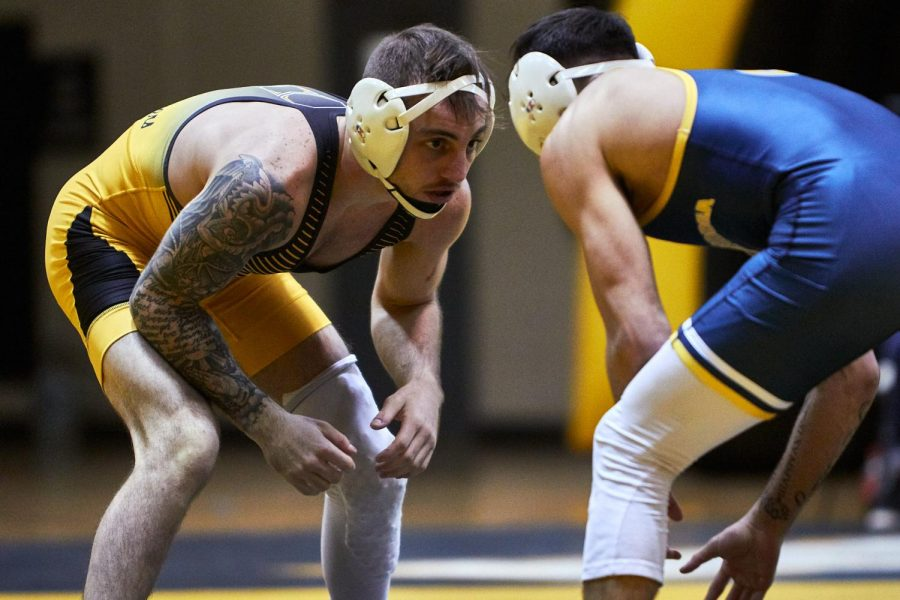 App State senior Codi Russell wrestles against Chattanooga's Fabian Gutierrez in Boone on Sunday. Russell won the matchup of top-25 ranked opponents with a 4-3 decision.