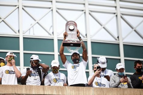 Sophomore forward RJ Duhart hoists the Sun Belt tournament trophy in front of a crowd of Mountaineer faithful. Duhart started at center for the Mountaineers after junior James Lewis Jr. got injured in the quarterfinals. Duhart played a combined 79 minutes in the semifinal and championship rounds, helping his team to its first ever Sun Belt tournament title.