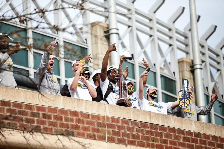 App State's basketball team celebrates its first ever Sun Belt title at the team's welcome-home gathering outside the Holmes Center in Boone March 9. Junior guard Adrian Delph (center) holds the conference championship trophy.