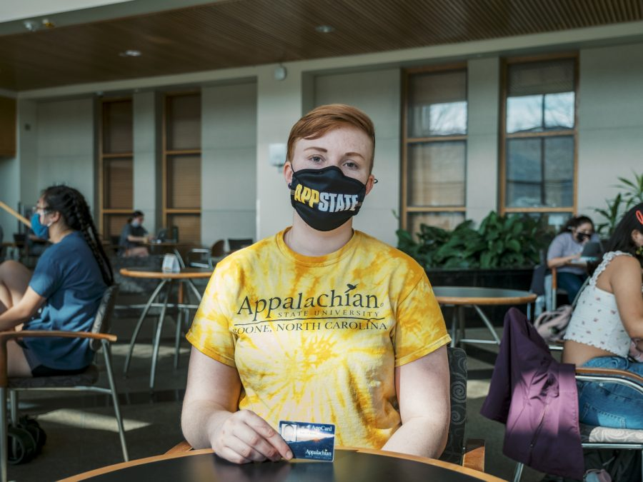 Kale Barns poses with their AppCard. Barns is one of a number of students who would be impacted by legislation that would offer the use of preferred names on AppCards.