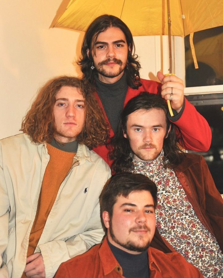 App State students Jake Fain, Ben Burrows, Aaron Huntley and Forrest Britt pose for a band photo. Their band, Dropping Plates, used social media to gain listeners while the pandemic kept them from performing live.