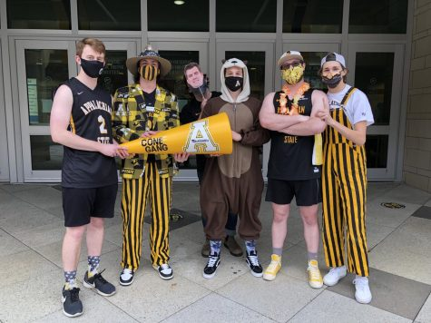 "The ""Cone Gang."" From the left: Will Strickland, Bailey Lang, ""Dusty Korns,"" Parker Stone, Andrew Curry and Will Taylor welcomed the App State men's basketball team home from the Sun Belt championship last week. The crew is invested in all App State sports, and rally online, usually on Twitter, to support university athletics."