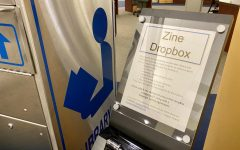 The dropbox for zines in Belk Library beside the service desk. Students have until March 16 to complete a zine and turn it into the dropbox before the library puts them on display.