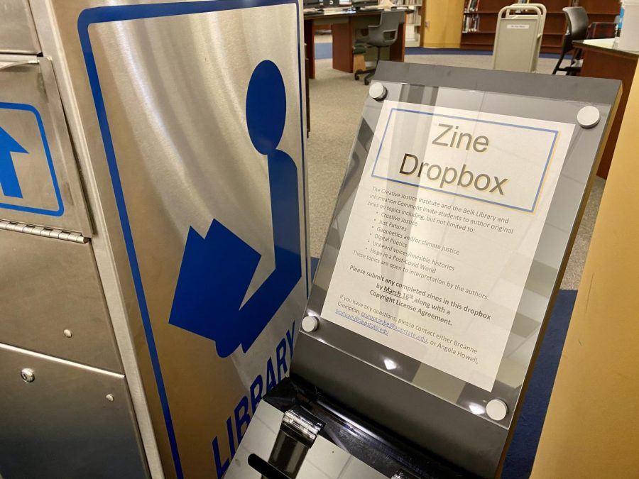 The+dropbox+for+zines+in+Belk+Library+beside+the+service+desk.+Students+have+until+March+16+to+complete+a+zine+and+turn+it+into+the+dropbox+before+the+library+puts+them+on+display.