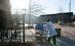 Medical workers bring supplies into the Holmes Convocation Center on Thursday in preparation for the App State vaccination rollout.
