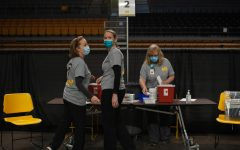M.S. Shook Student Health Service workers prepare for people to get vaccinated the morning of the clinic.