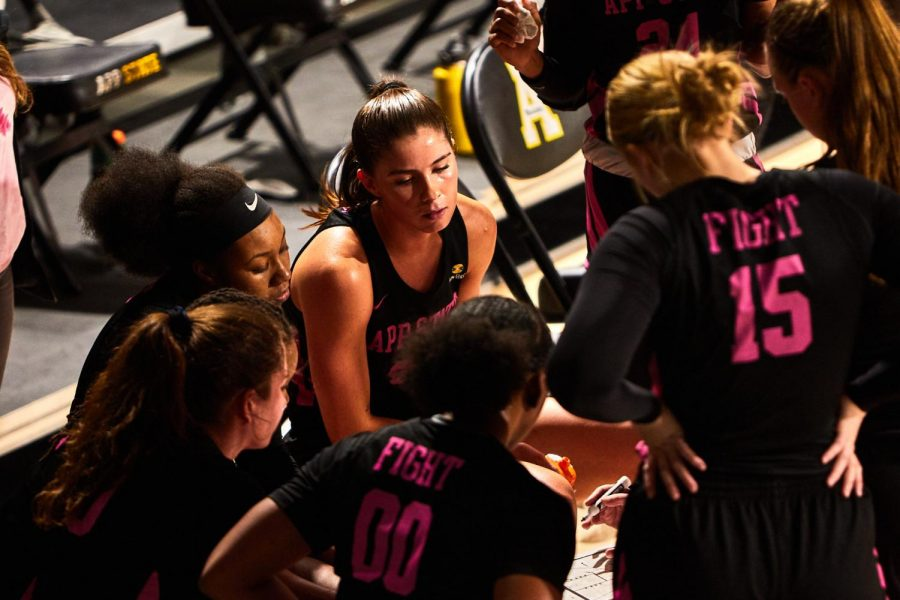 App State women's basketball players catch their breaths during a timeout against Coastal Carolina Feb. 13 in Boone. Senior forward Lainey Gosnell (pictured at center, looking down) led the Mountaineers to a pair of wins over Georgia Southern in the final series of the regular season this past weekend. She was named Sun Belt Player of the Week on Monday.