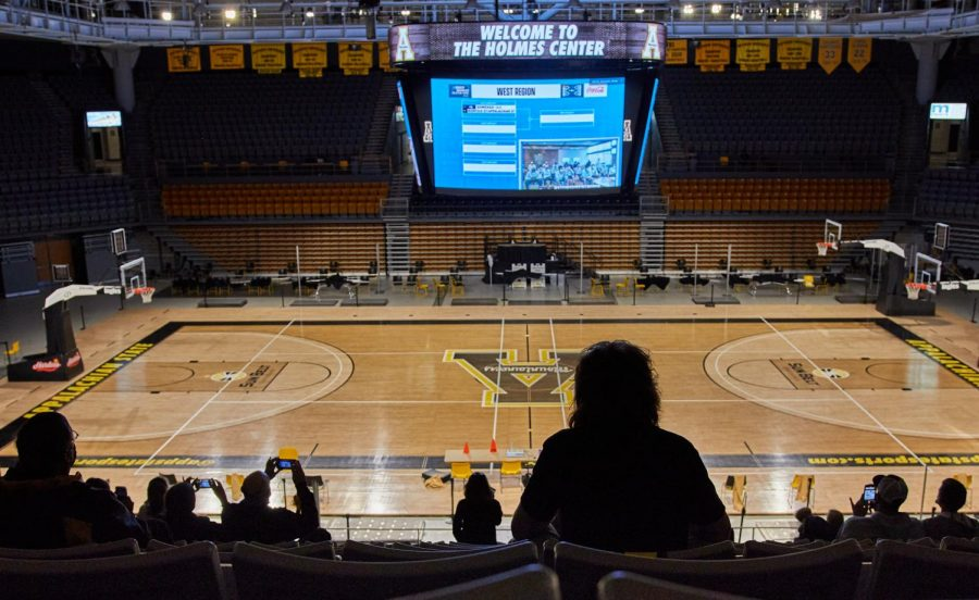 "App State fans watched from the Holmes Convocation Center as the Mountaineers' seeding and matchup for the NCAA Tournament were released during the annual selection show. ""Oh my gosh, it's so exciting to be back in the stadium,"" said Denise Lovin, an App State fan and Boone local."