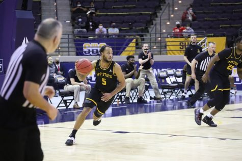 App State grad transfer guard Michael Almonacy looks up the court during the Mountaineers