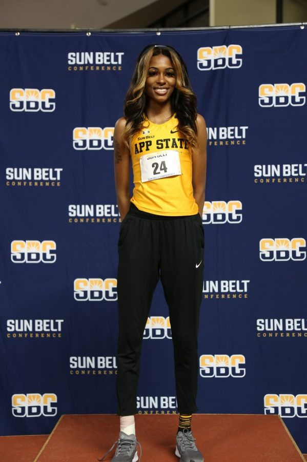 App State senior sprinter and jumper Peighton Simmons stands atop the podium at the 2021 Sun Belt indoor track championships in Birmingham, Alabama Feb. 22-23. Simmons won the triple jump Sun Belt title for the first time in her career, becoming App State's 16th triple jump conference champ in program history.