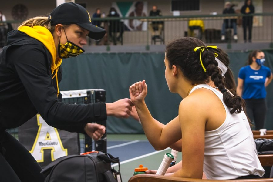 App State first-year head coach Ashleigh Antal (left) and senior María José Zacarias (right) share a fist bump during the Mountaineers' win over Georgia State Saturday in Boone. The Mountaineers also knocked off Georgia Southern Sunday to open conference play 2-0.