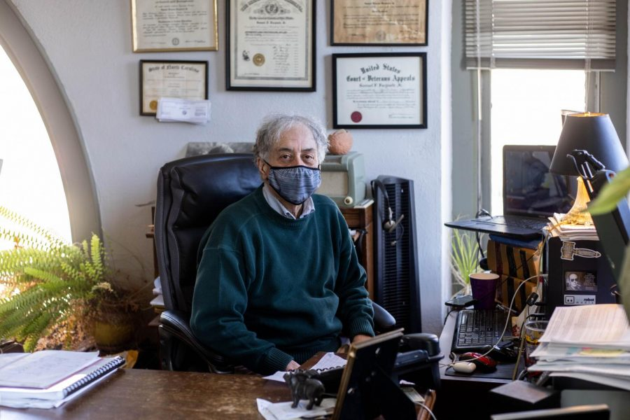 Town council member Samuel Furgiuele, Jr. poses at his desk in his office on King Street. During the pandemic, Furgiuele has attended weekly council meetings over Webex from his office.