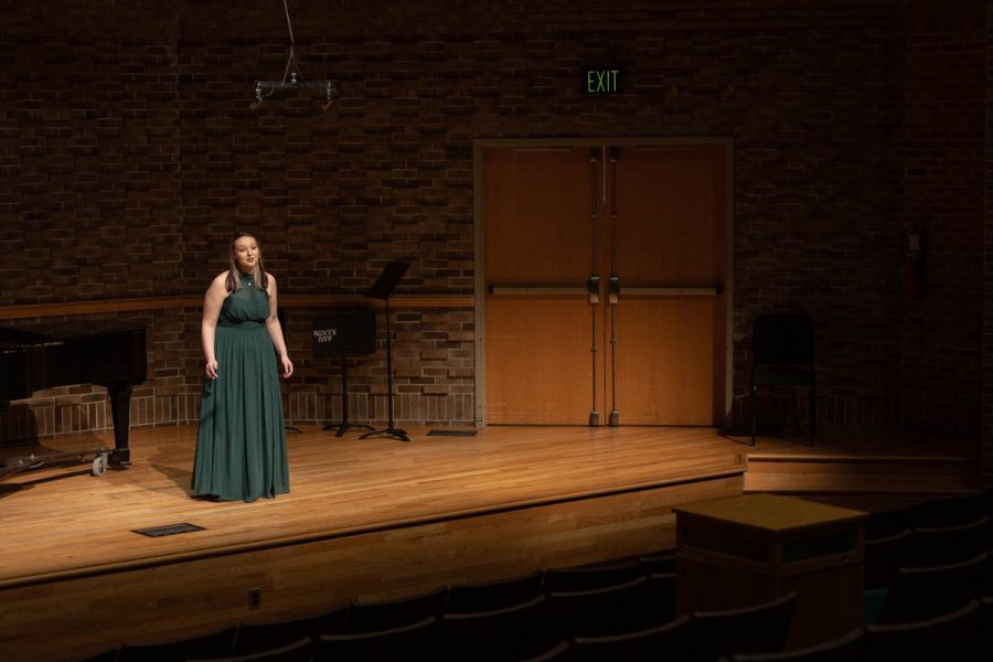 """Kinsey Crabb, senior choral music education major, sings two pieces accompanied by Susan Slingland, staff accompanist. Crabb performed """"There are Fairies at the Bottom of our Garden"""" by Liza Lehmann and """"Come Down Angels"""" by Undine Smith Moore for the """"Music by Women Composers"""" concert."""