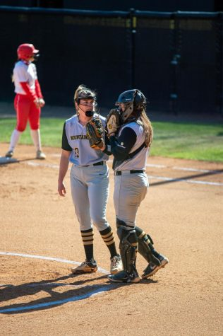 App State senior catcher Baylee Morton (right) visits with senior pitcher Sydney Holland on the mound during Saturday