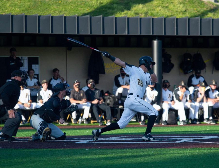 App State super senior infielder Robbie Young follows through on a swing against Wake Forest April 13 in Boone. Young has started all 28 games this year for the Mountaineers and ranks third on the team with a .289 batting average.