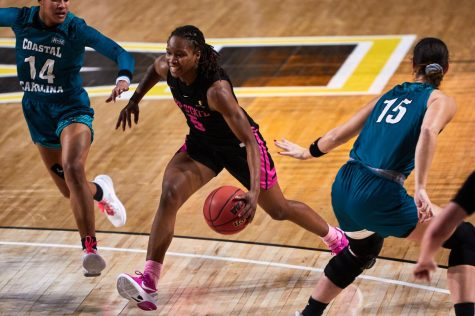 Former App State guard Pre Stanley (pictured at center) signed the first WNBA contract in program history April 16, inking a training camp deal with the Washington Mystics.
