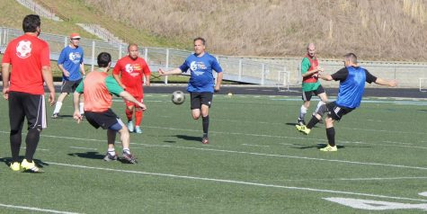 Adult soccer players from around the world compete on the pitch at High Country Soccer Association