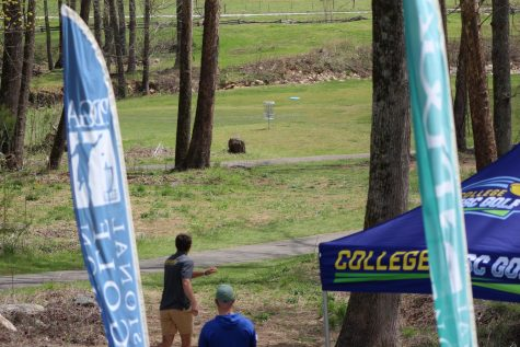 App State disc golfer Matt DaCosta watches a drive sail towards the basket at the collegiate disc golf national championships April 7-10 in Marion, NC.