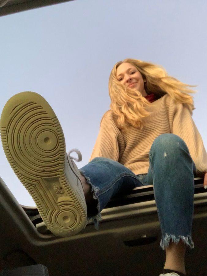 Grace+Abbott+on+the+roof+of+a+car.+Abbott+enjoys+going+on+drives+to+destress+from+class.+