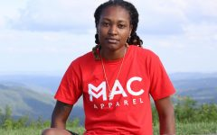 Maya Calder wearing a shirt from her clothing line, Mac Apparel.