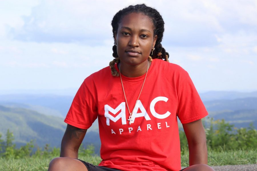 Maya Calder wearing a shirt from her clothing line, Mac Apparel.