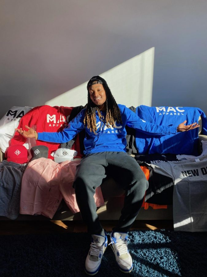Maya Calder surrounded by clothes from Mac Apparel. Calder said she's always had an interest in business.
