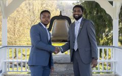 Bailey Gardin (right) and DJ Evans (left) shake hands during their swearing-in ceremony.