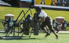 """App State freshman offensive lineman Jaden Lindsay hits a sled during spring practice this season. """"He has a long way to go, but he's come a long way in nine practices,"""" Mountaineers head coach Shawn Clark said."""