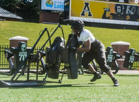 "App State freshman offensive lineman Jaden Lindsay hits a sled during spring practice this season. ""He has a long way to go, but he's come a long way in nine practices,"" Mountaineers head coach Shawn Clark said."