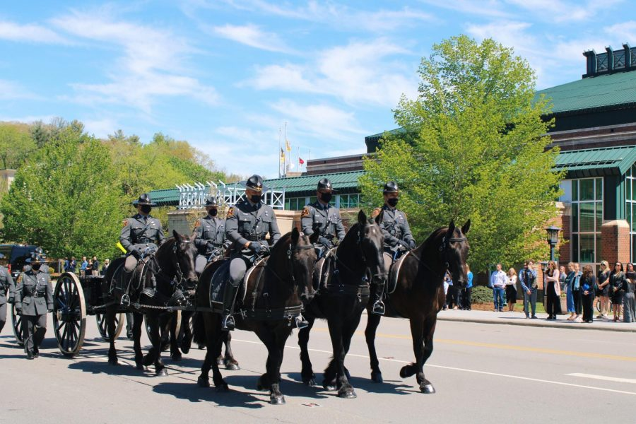 The North Carolina Troopers Association Caisson Unit assisted in the procession on Thursday afternoon for Sgt. Chris Ward and K-9 Deputy Logan Fox.