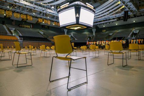 After staff sanitized the socially distanced seating areas, the Convocation Center remained empty until the next round of graduating students entered for their commencement ceremony.