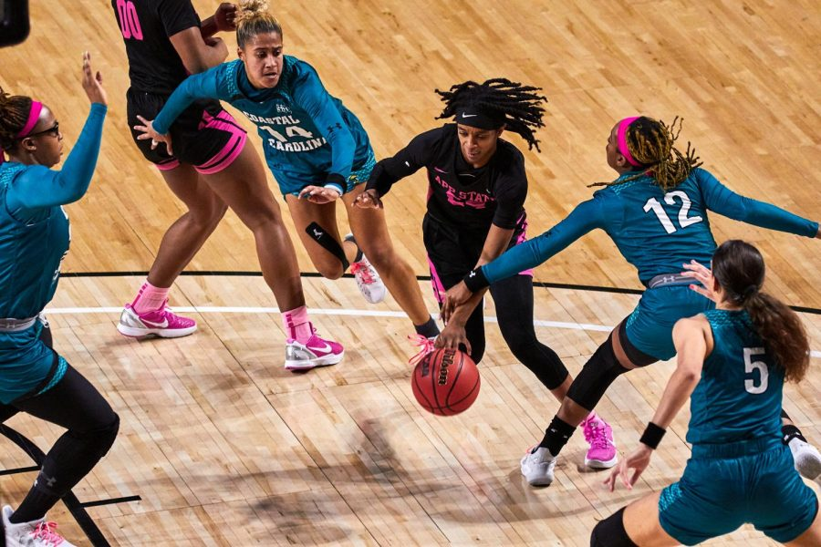 Redshirt junior Janay Sanders attacks the paint in the Mountaineers' annual Pink Game vs Coastal Carolina. Sanders averaged 10.9 points, 3.2 rebounds and 1.4 assists per game as a sophomore and started in 10 games.