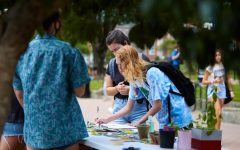 ClimACT set up a table Monday on Sanford Mall. As  students walked by their table they could join the club, pick up free seed or sign a petition.
