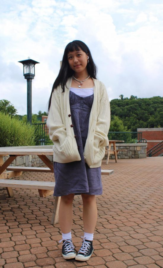 """Wearing an oversized thrifted cardigan, Ailysa Lee describes her style as """"all over the place."""" Aiming for a """"soft girl"""" and dainty look, Lee took advice from her sister that she should dress according to the weather in Boone."""