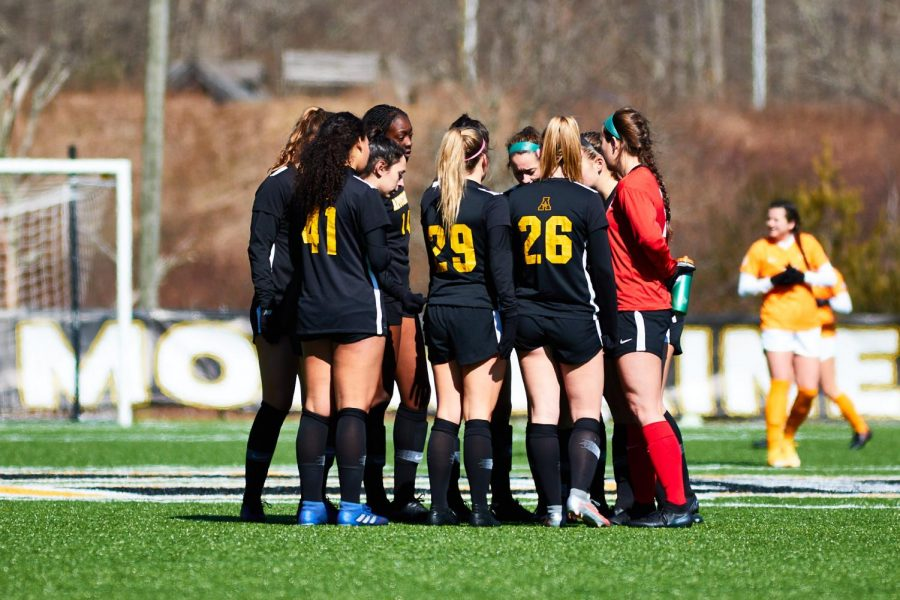Women's soccer huddles up during their spring match against Tennessee. The Mountaineers played in three games during their spring season and finished 1-2.