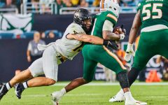 Senior inside linebacker T.D. Roof wraps up star Miami quarterback D'Eriq King. Roof posted two sacks and seven total tackles against the No. 22 Hurricanes.