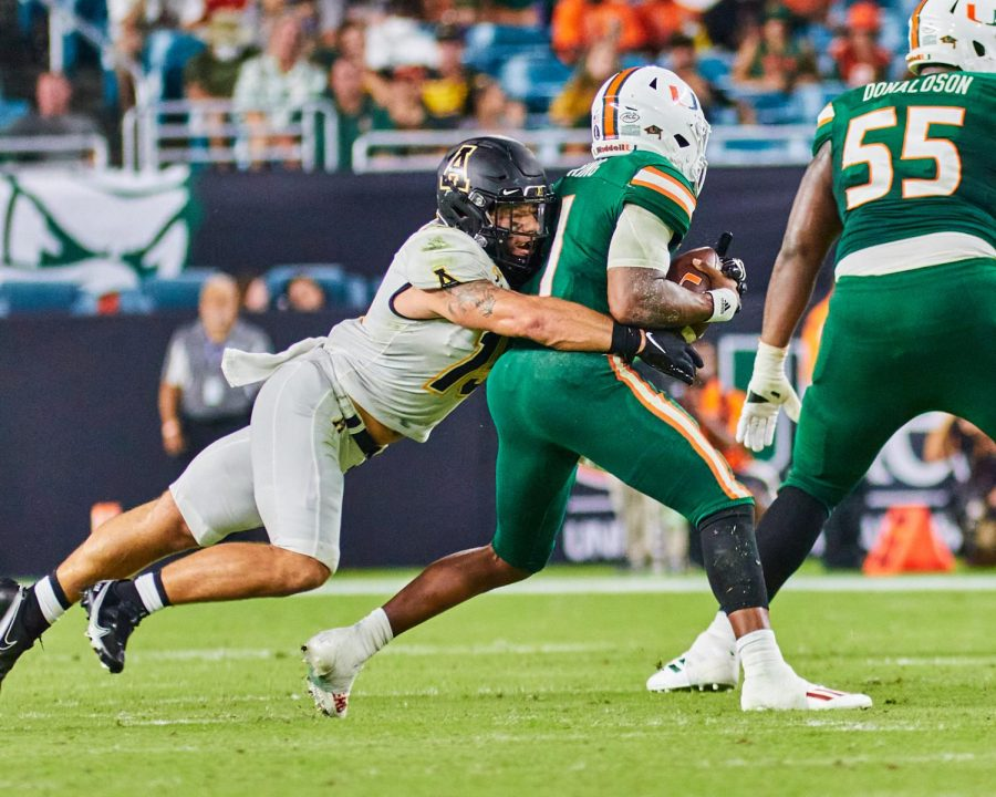 Senior inside linebacker T.D. Roof wraps up star Miami quarterback DEriq King. Roof posted two sacks and seven total tackles against the No. 22 Hurricanes.