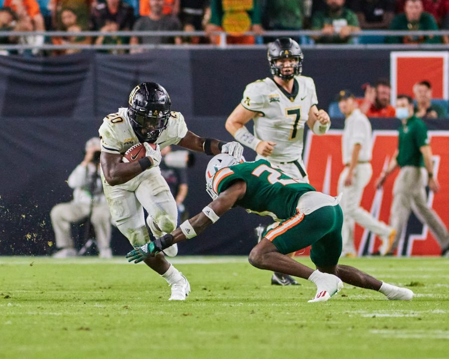 Sophomore running back Nate Noel avoids a Miami defender during one of his 16 rush attempts. Those 16 attempts were good for 51 yards as the Miami native played in front of his hometown.